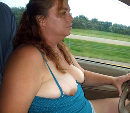 Mature woman drives and shows her big..