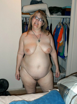 Chubby mature wife is cooking dinner..