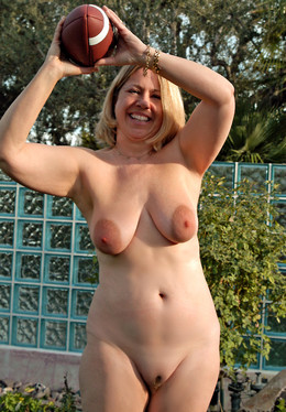 Muscular middle-aged woman posing..