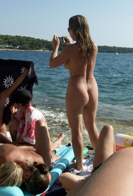 Naked Mom on the free beach, nudists..