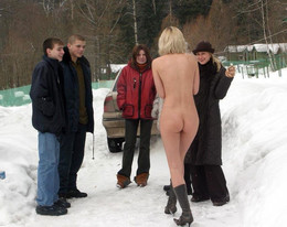 Luscious blonde posing naked outdoor..