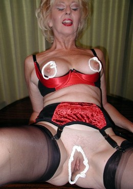 Blonde granny with really red pussy..