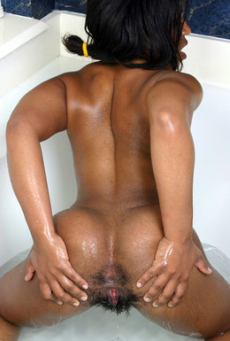 Gently ebony cutie bares her tits and..